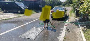 Amendă pentru covor spălat pe stradă!